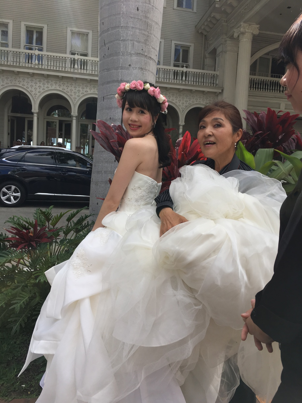Bride and her stylist outside the Moana Hotel in Waikiki.